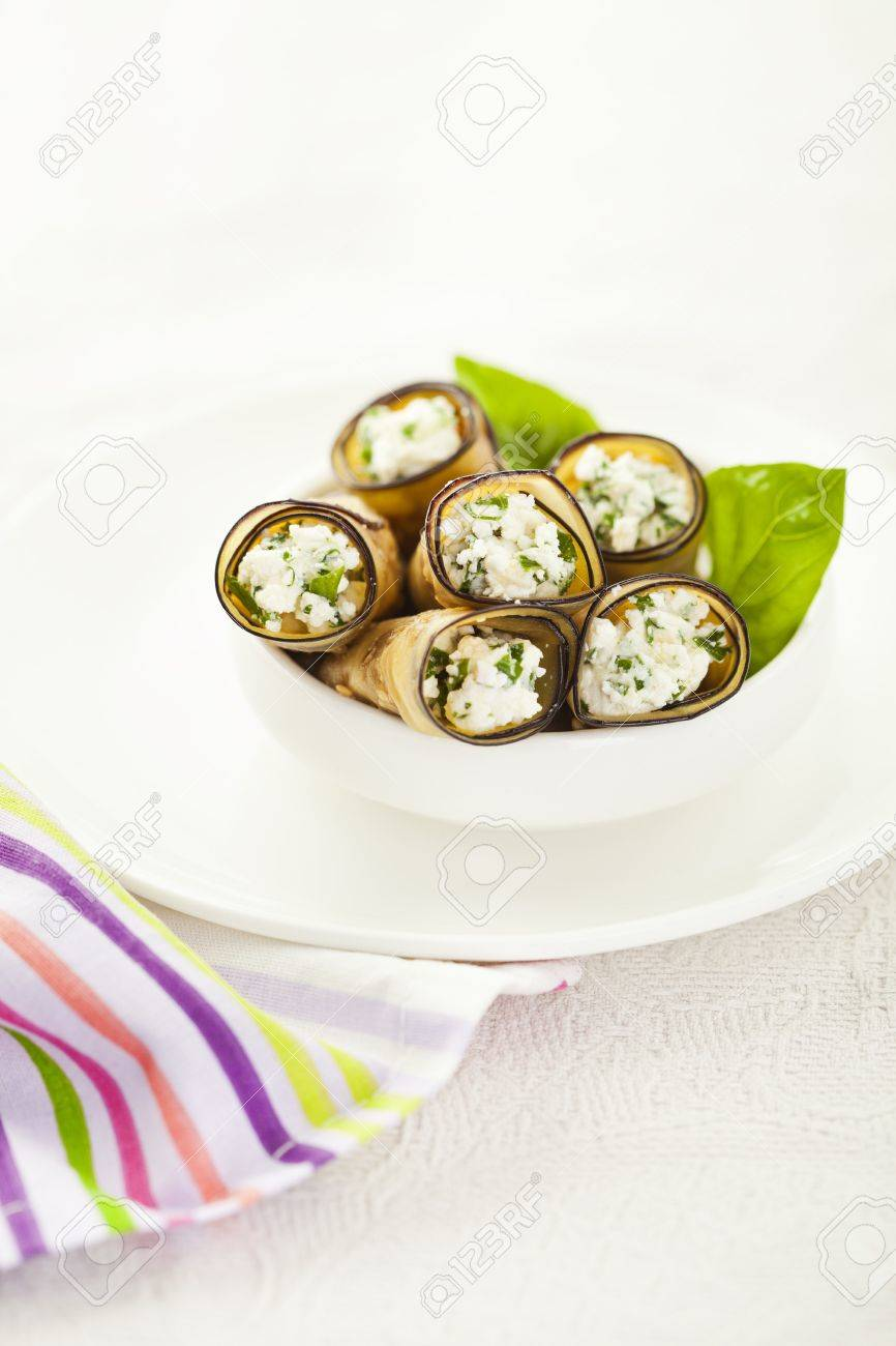Tasty eggplant rolls stuffed with cottage cheese Stock Photo - 14953880