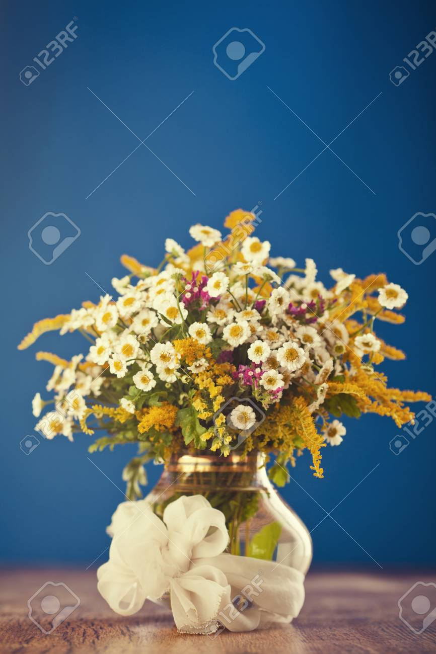 Beautiful bouquet of wild flowers on wooden table Stock Photo - 18151067