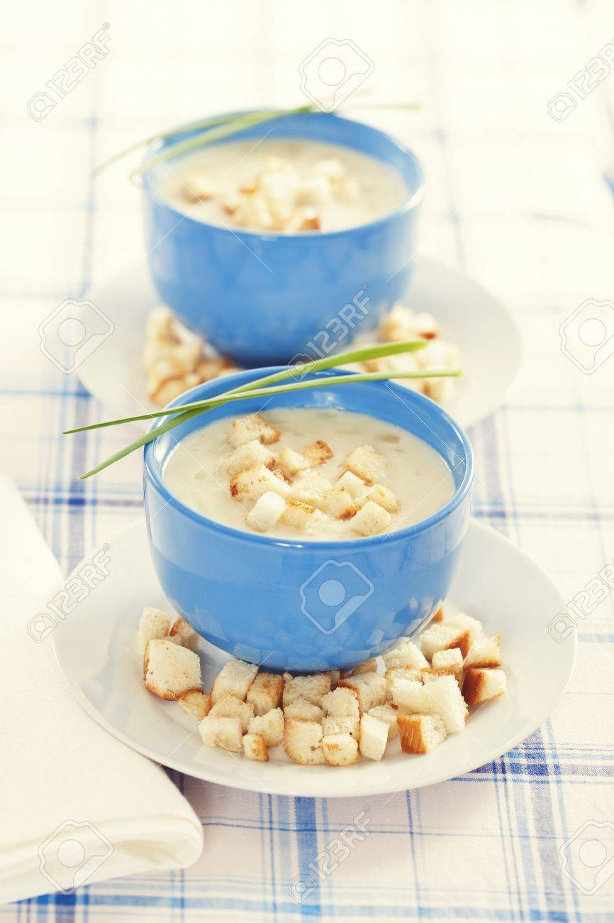 Vegetable cream soup in blue bowls Stock Photo - 19009067