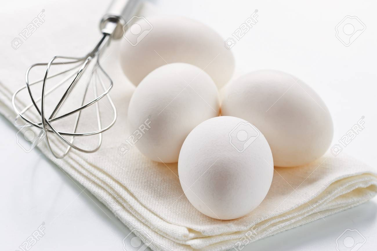 Fresh eggs with whisk for baking Stock Photo - 19009098