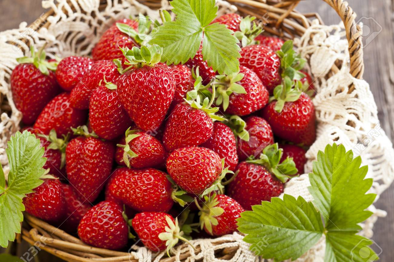 Strawberries in basket on rustic wooden background Stock Photo - 20461847