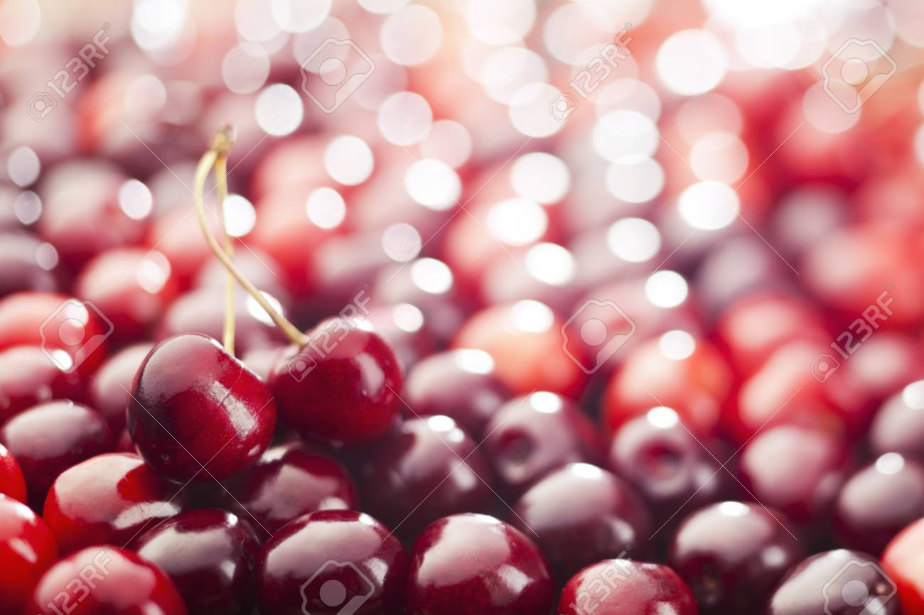 Red cherries background  Shallow depth of field Stock Photo - 21085785