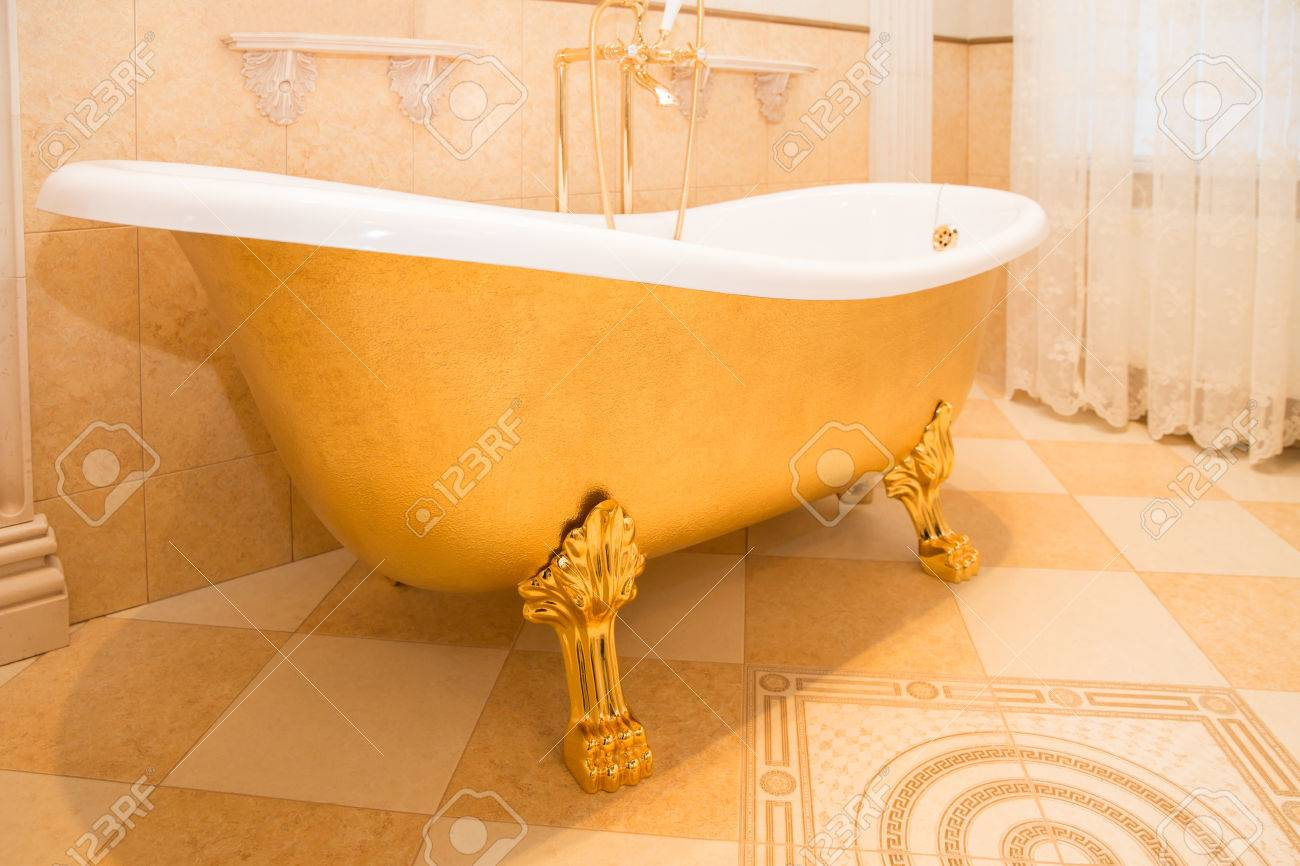 Old Fashioned Luxirious Golden Bath Tub In A Bathroom Stock Photo ...