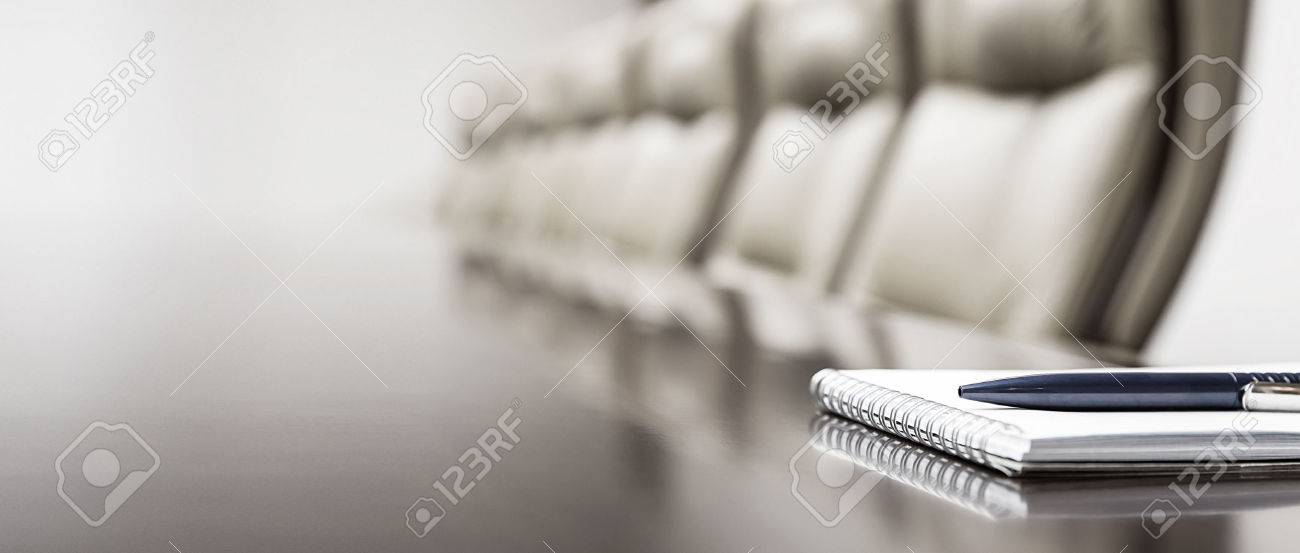 Closeup of notepad kept on table in empty conference room - 43025214