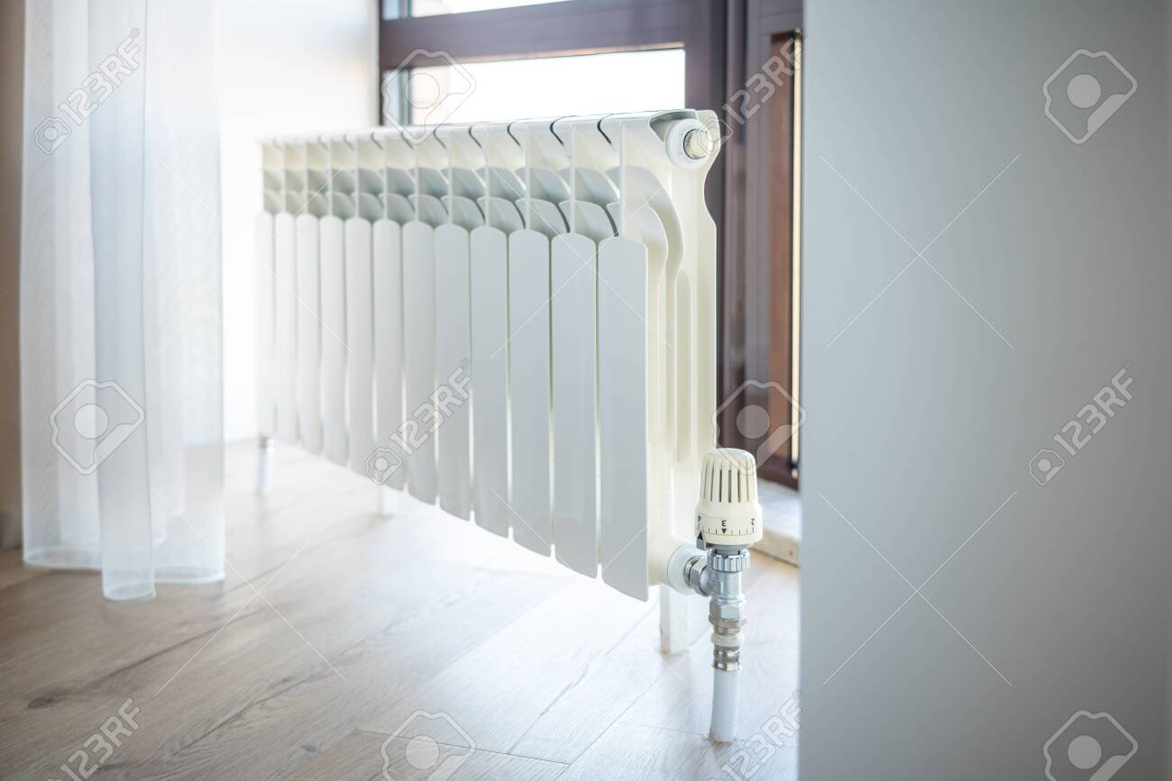White Big Radiator With Thermostat Near Window In Modern Room Stock Photo Picture And Royalty Free Image Image 136035521