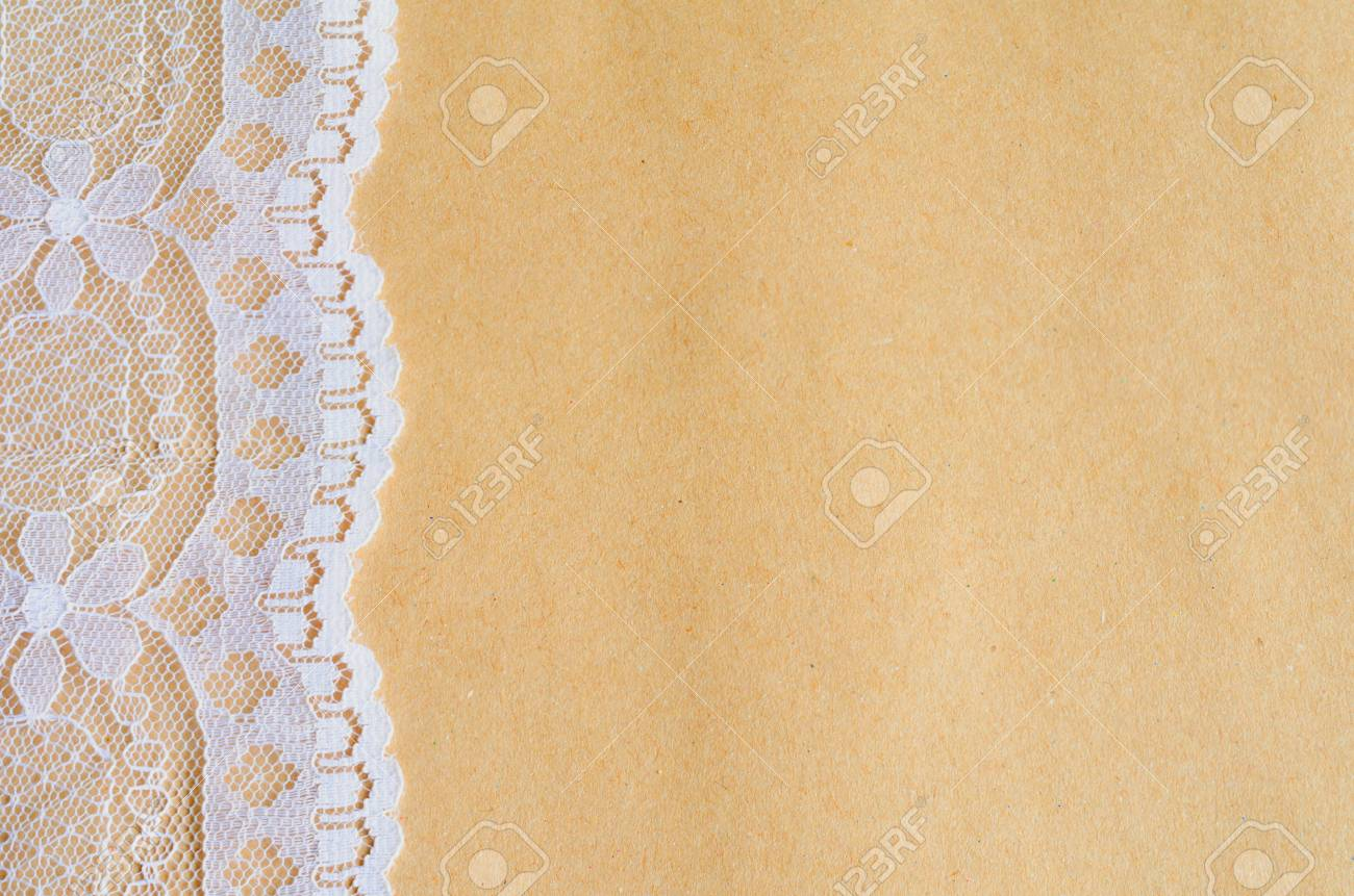 Rustic Vintage White Lace On Craft Parchment Paper Background Stock Photo