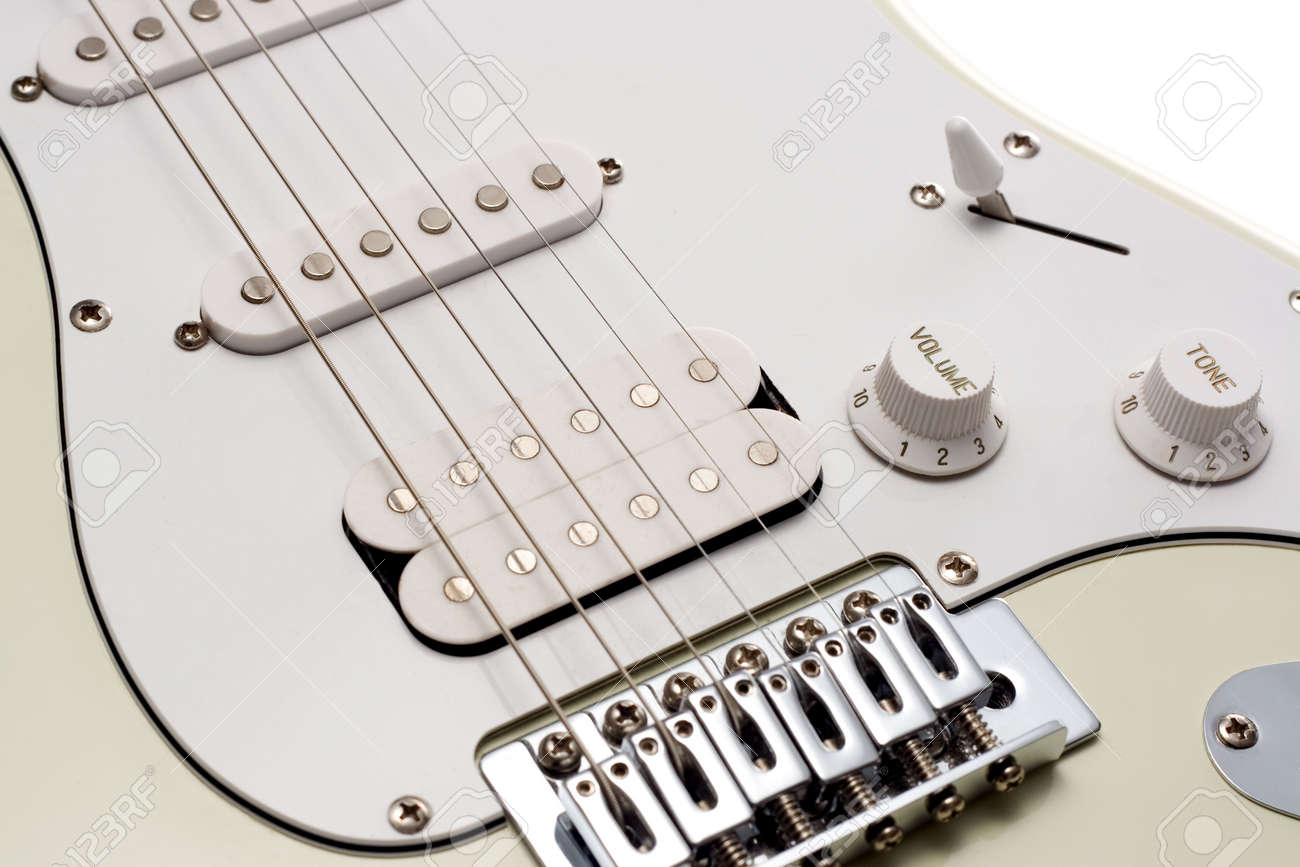 Close Up Of The Pickups And Bridge Of A White Electric Guitar