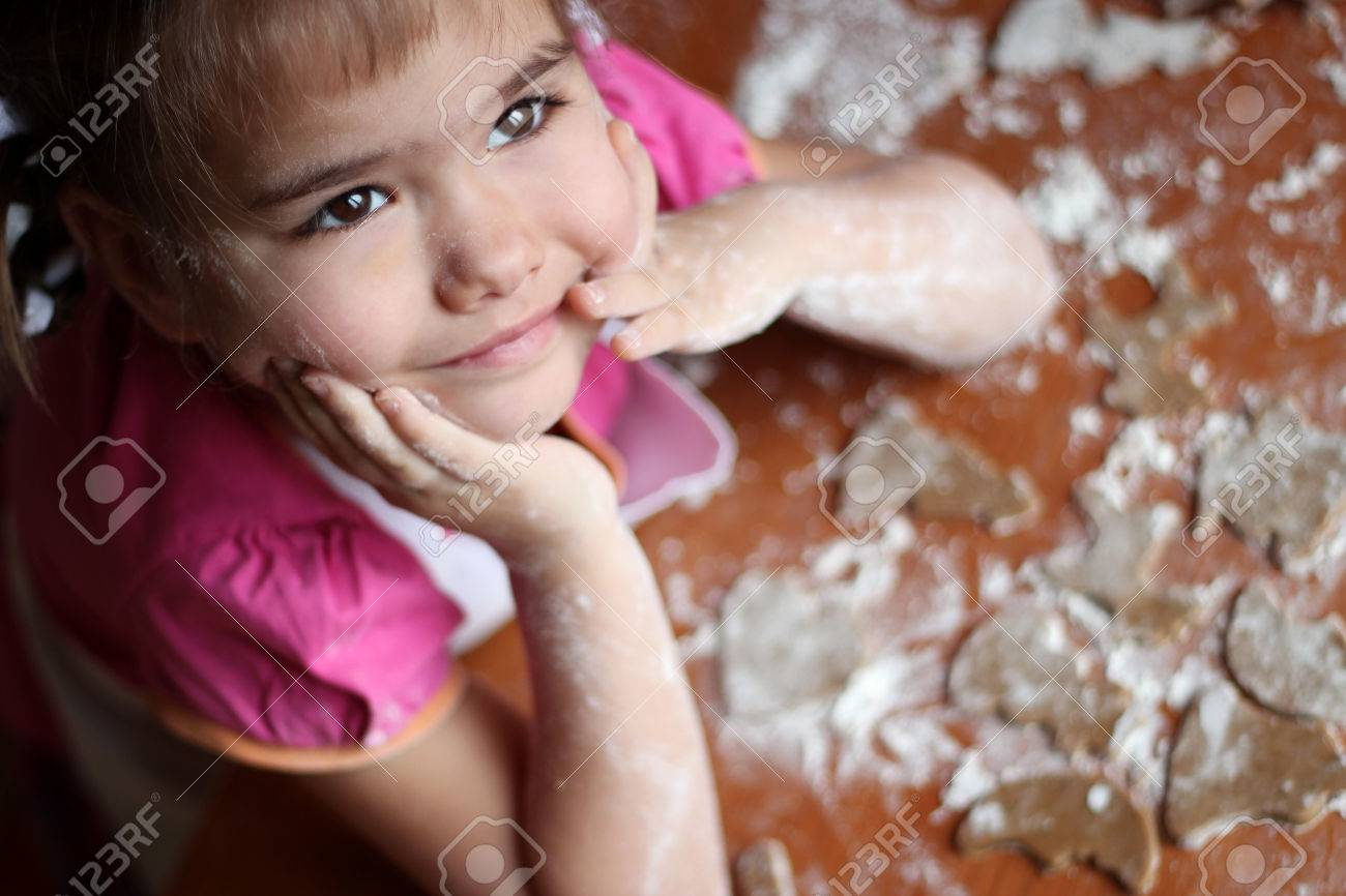 White apron girl - Portrait Of Pretty Little Girl In White Apron Dreaming About A Gift From Santa Claus For