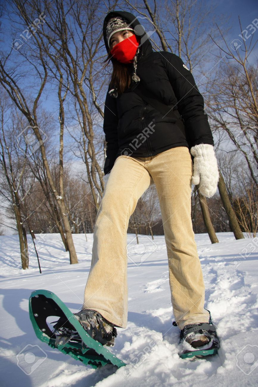 Young woman hiking with Snow shoes / Rackets in Quebec, Canada Stock Photo - 4103344