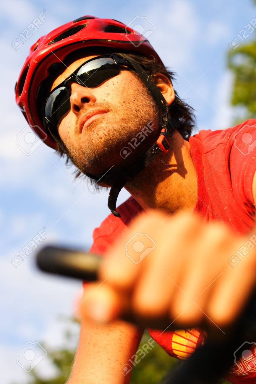 Closeup of young man riding a mountain bike in the forest on a sunny day Stock Photo - 5216242