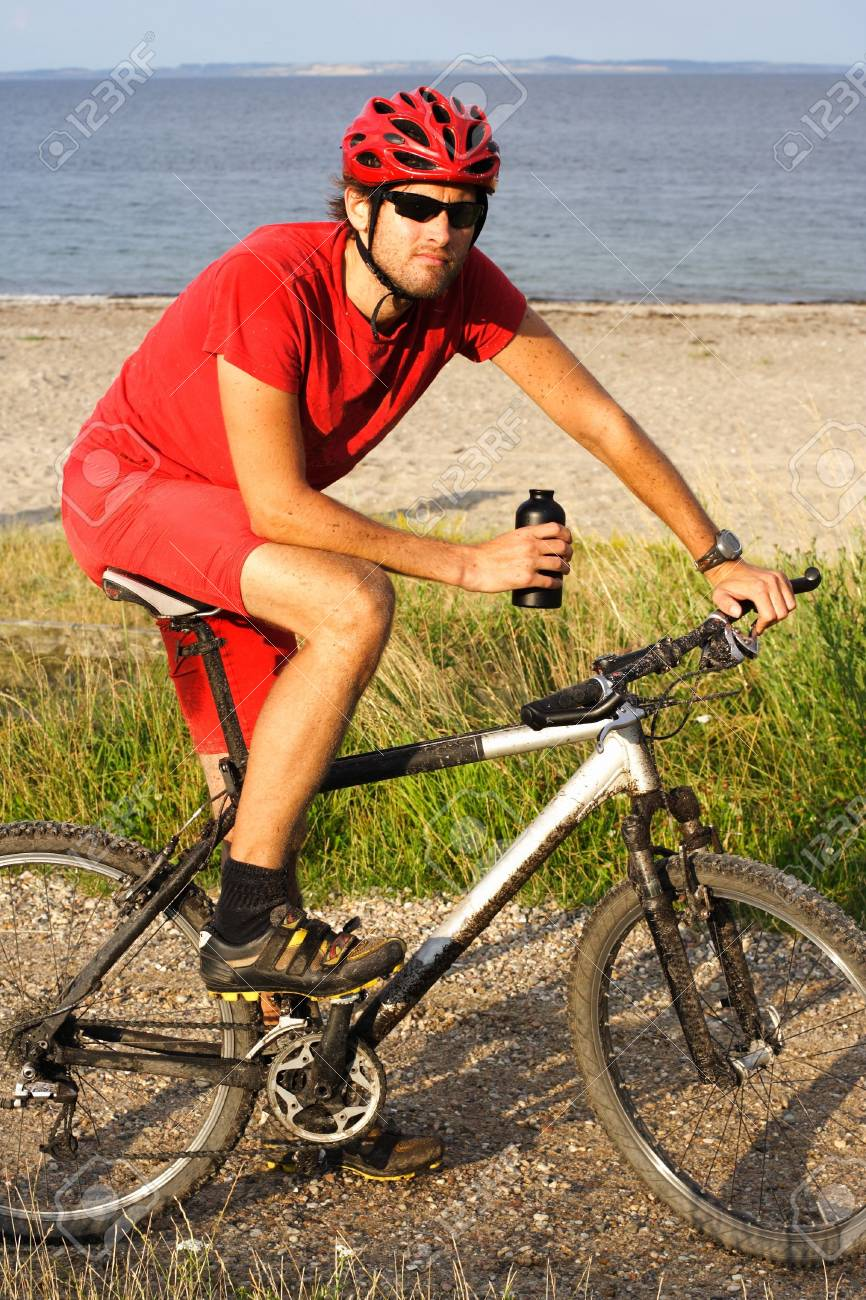 young man taking a break after extreme biking Stock Photo - 5395329