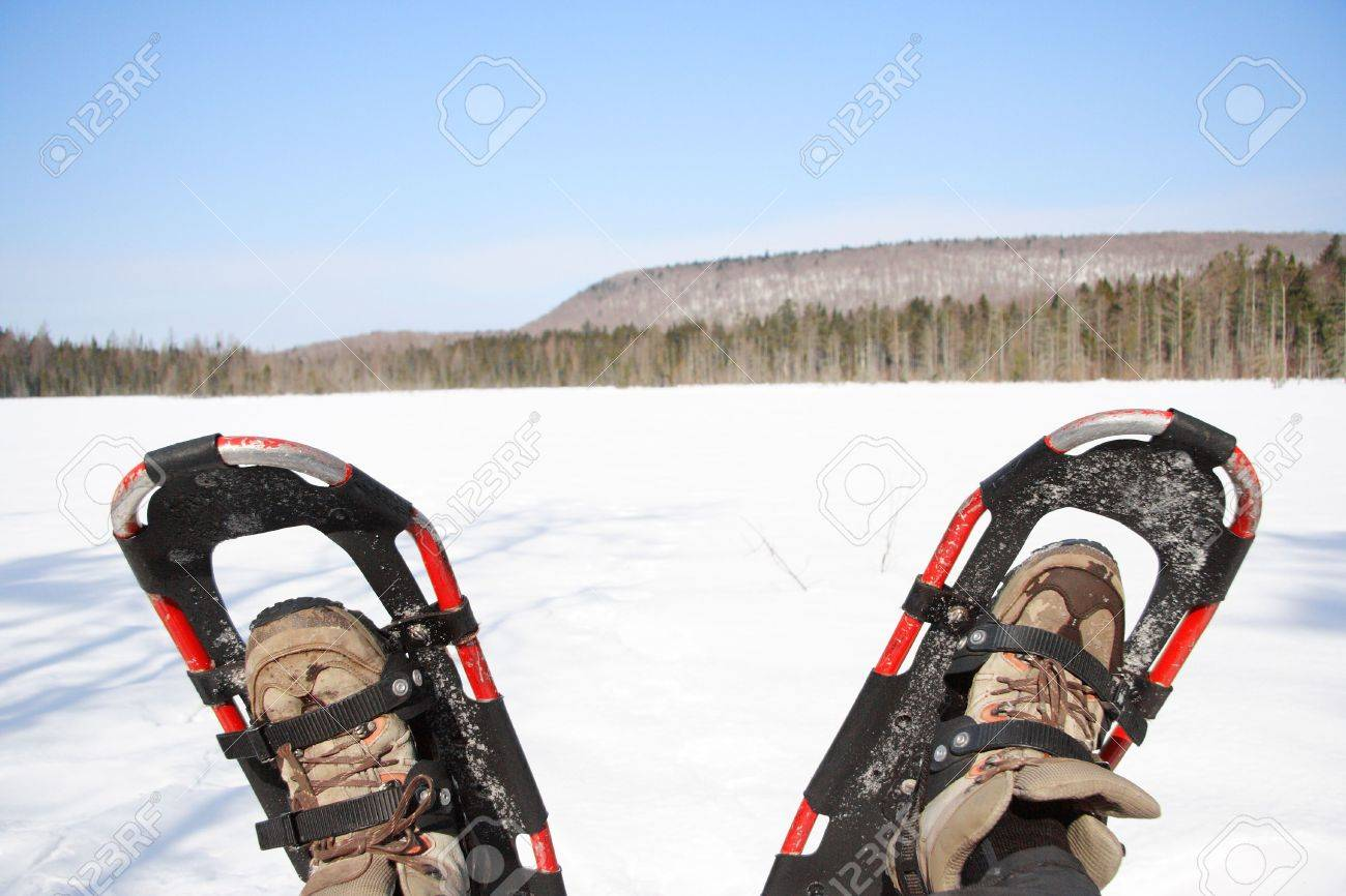 Snowshoes from a winter hike by a frozen lake in Quebec, Canada. Stock Photo - 5850458