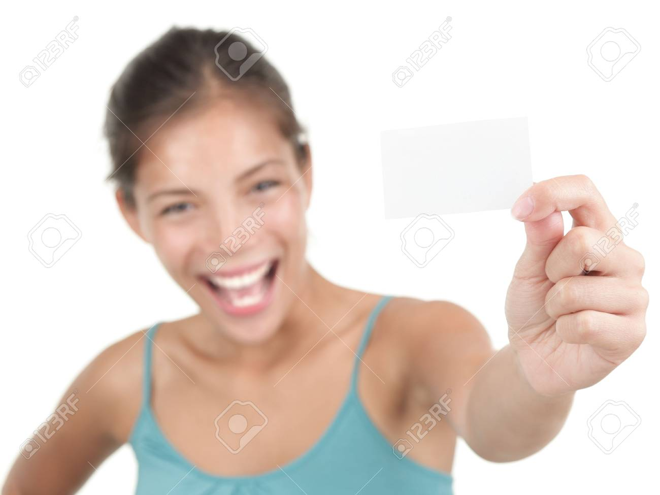 Beautiful young woman with a very excited big smile showing a white business card / notecard. S Stock Photo - 6221289