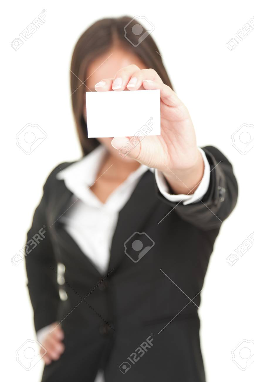 Businesswoman in suit holding business card. Beautiful (really!) mixed chinese asian / caucasian business woman. Isolated on seamless white background. Stock Photo - 6612742
