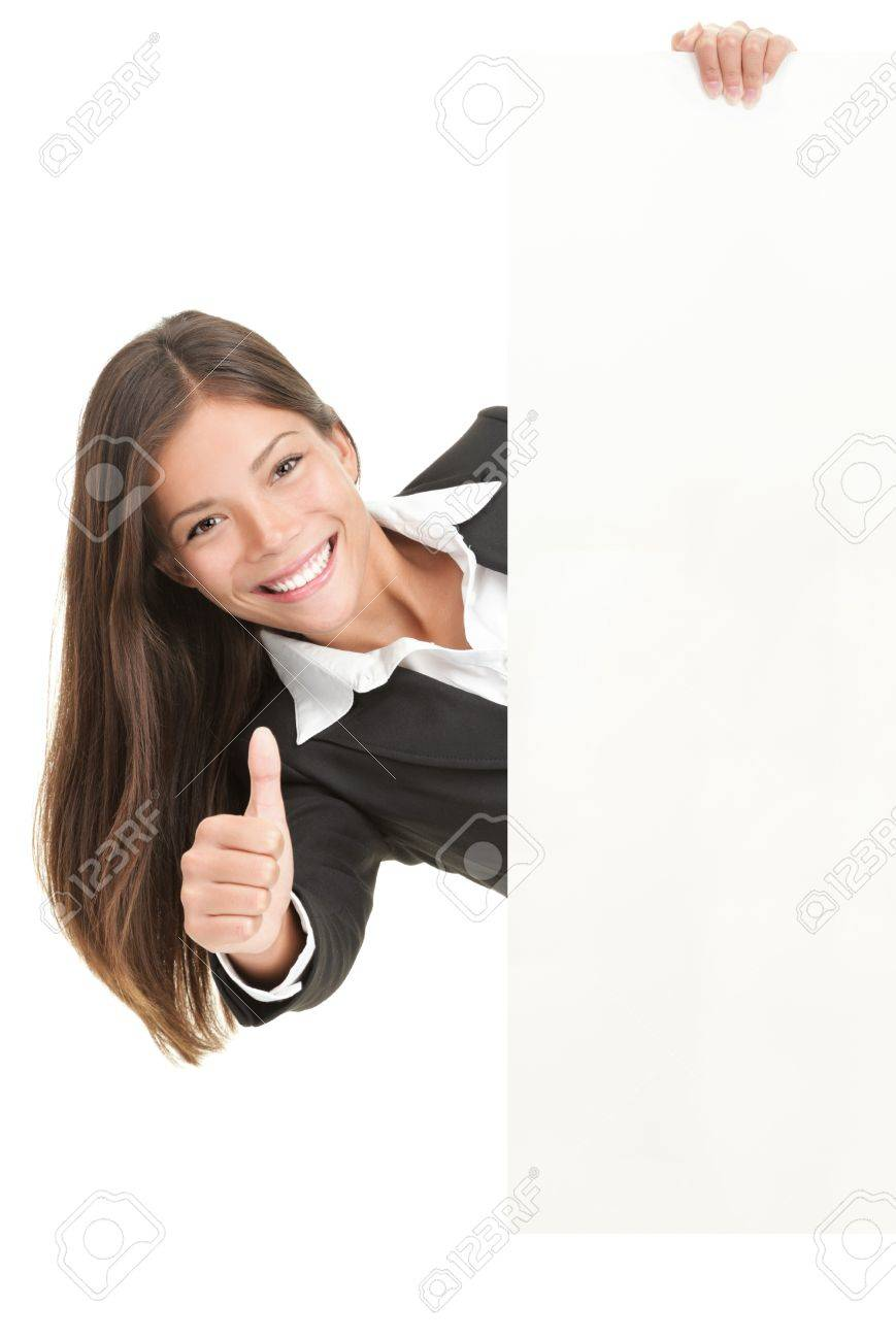 Advertisement woman holding sign. Businesswoman in suit giving the thumbs up success sign while showing a blank white billboard sign. Mixed race Chinese Asian / Caucasian woman isolated on white background. Stock Photo - 6988898