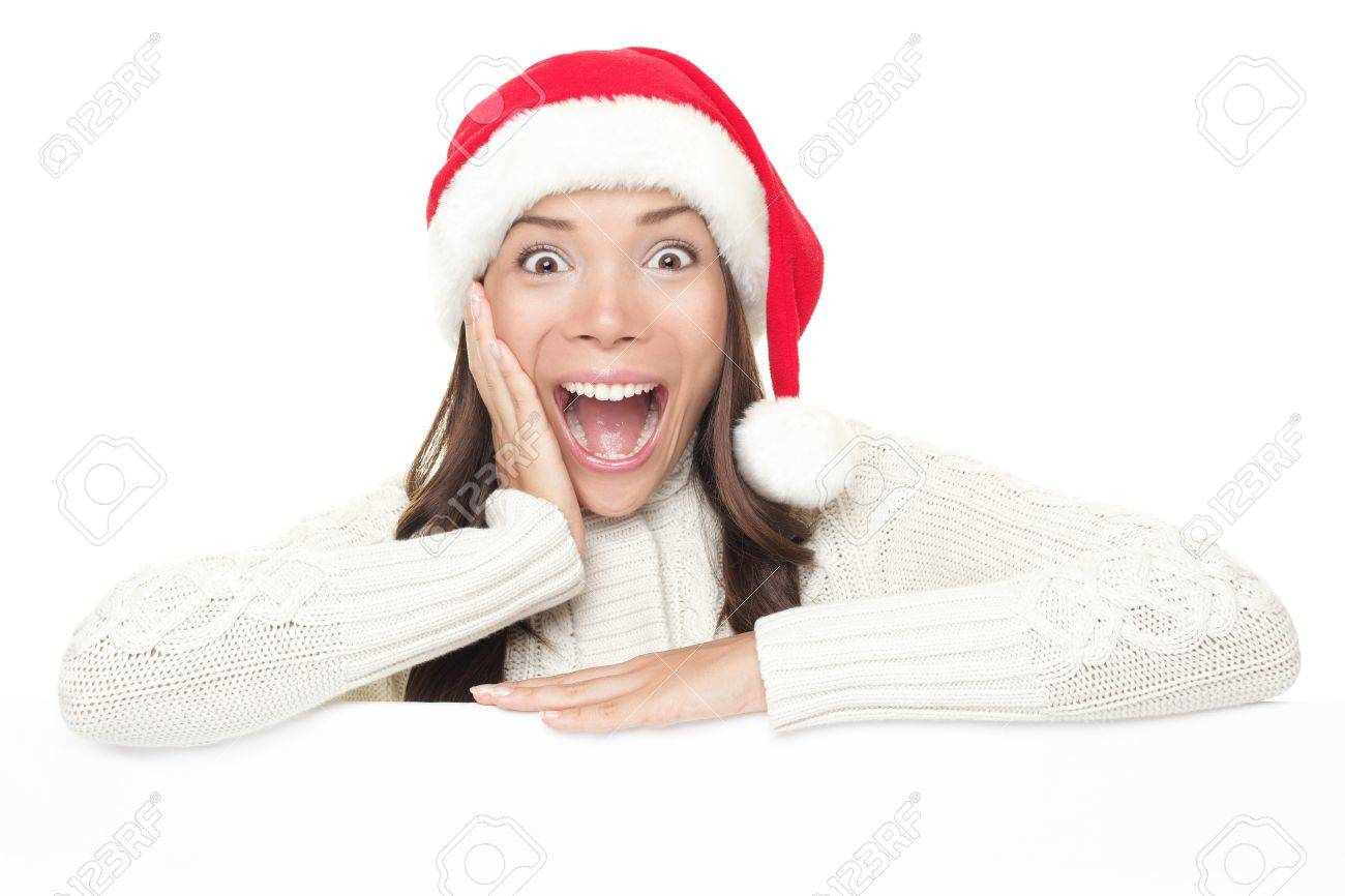 Billboard woman in santa hat leaning on banner for Christmas. Surprised asian beautiful happy model showing blank sign isolated on white background. Stock Photo - 8114696