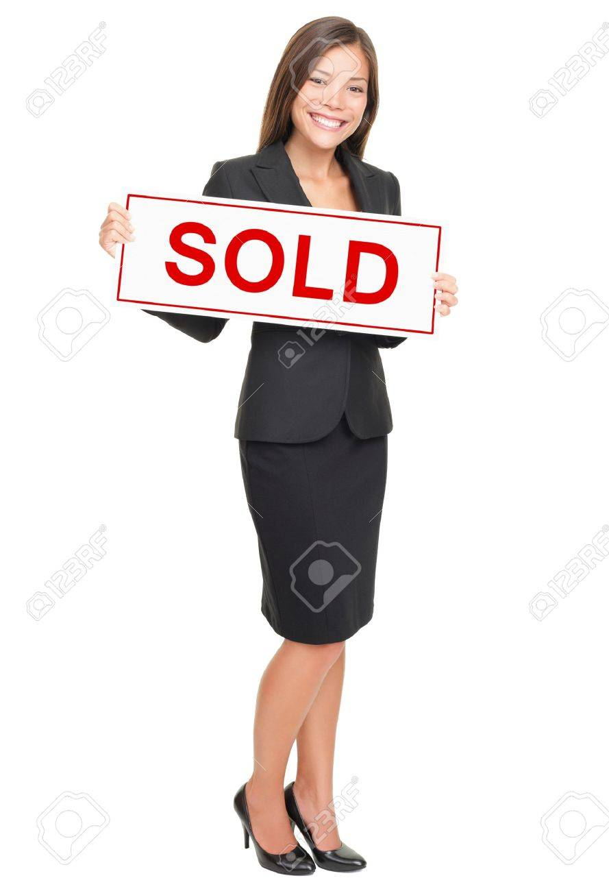 Real estate agent showing sold sign isolated on white background. Beautiful smiling Asian / Caucasian female realtor standing confident in full length. Stock Photo - 8297102