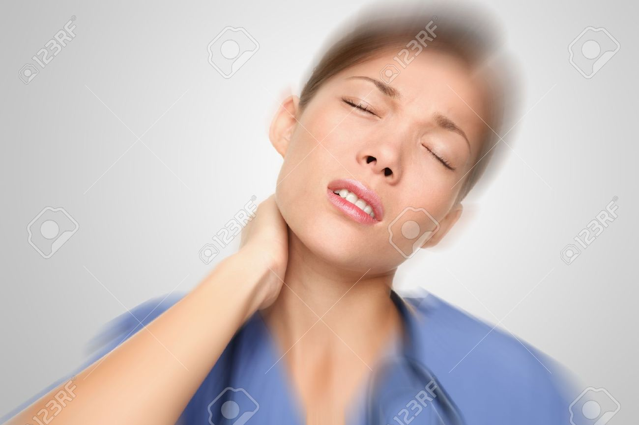 Nurse or young woman doctor having neck and back pain problems at work. Mixed-race Asian / Caucasian female model. Stock Photo - 8579941