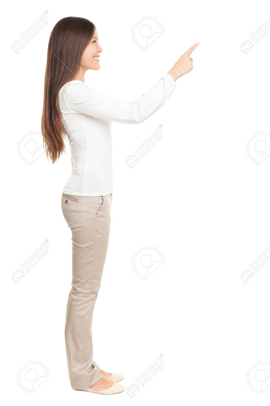 Isolated woman pointing or pushing something with index finger. Beautiful casual young woman isolated on white background in full length standing in profile. Stock Photo - 8828775