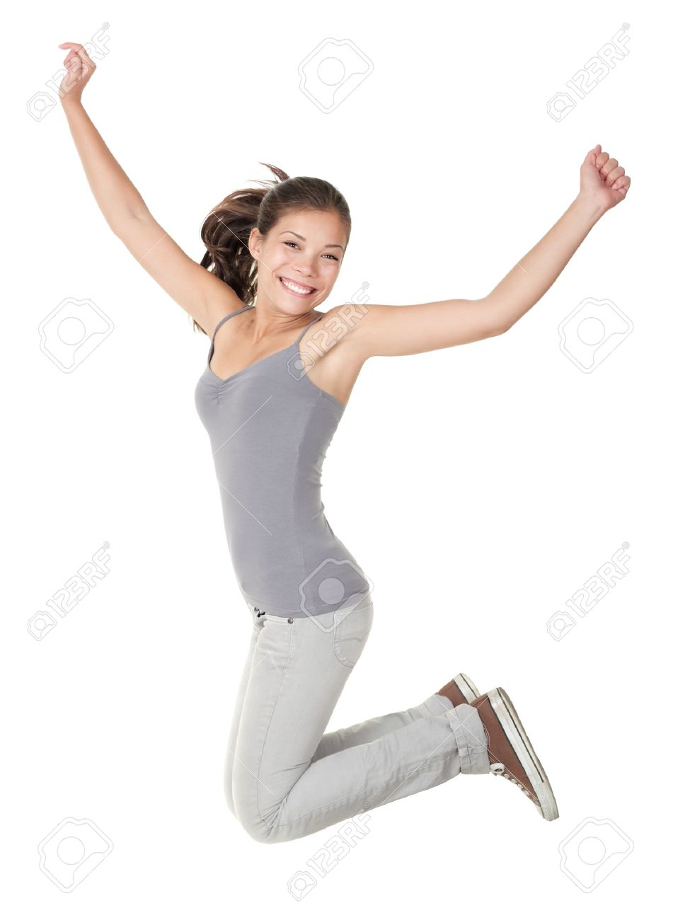 Jumping people isolated on white background: casual woman jumping happy and free in full body. Beautiful Caucasian Asian model smiling. Stock Photo - 8828794