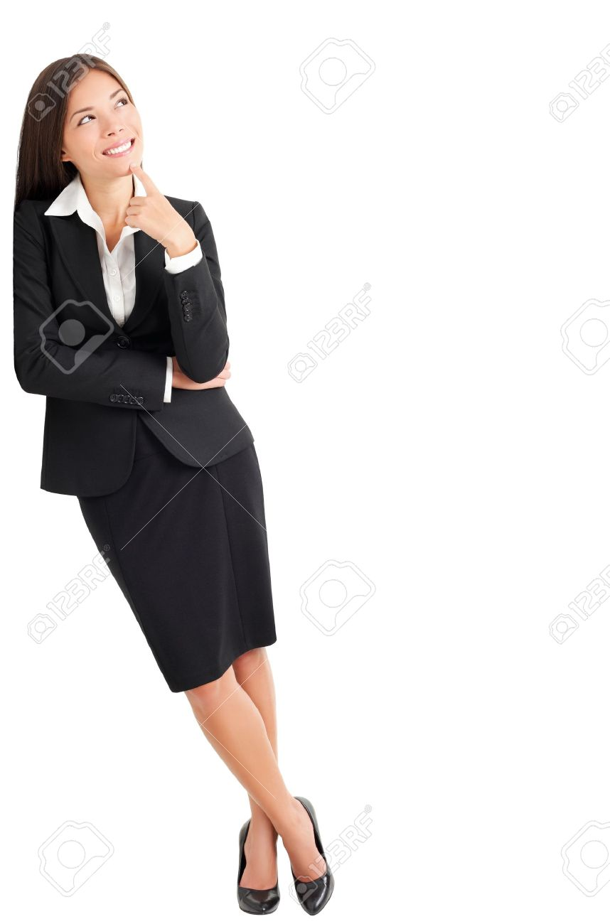 Businesswoman thinking leaning on wall looking up at copy space. Young mixed race Caucasian Asian professional woman isolated on white background Stock Photo - 9097595