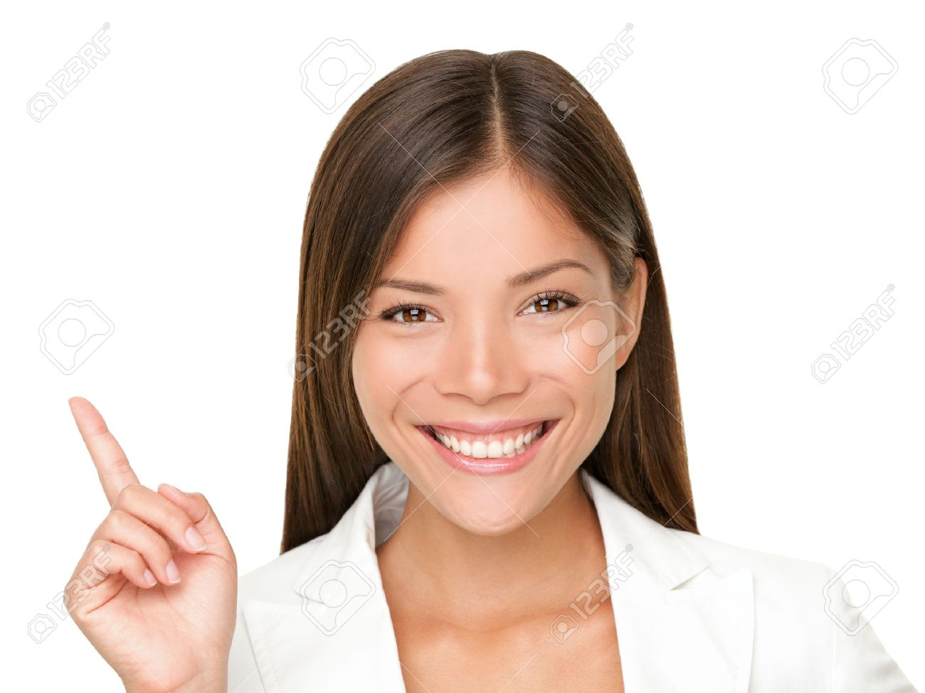 Woman smiling pointing up showing copy space. Closeup of beautiful young professional businesswoman isolated on white background. Stock Photo - 9097605