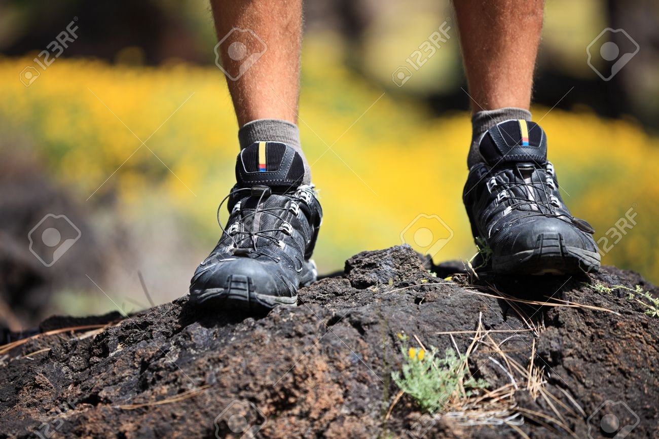 Hiking shoes closeup outdoors in action outside. Stock Photo - 9493550