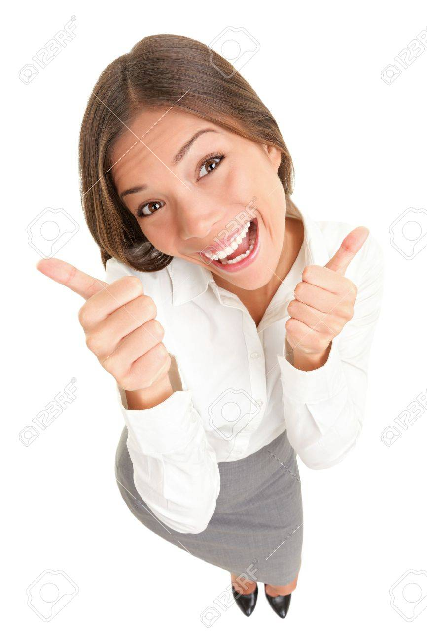 Happy thumbs up success woman isolated on white background. High angle top view image of cheerful joyous asian caucasian young woman smiling in full length. Stock Photo - 9577499