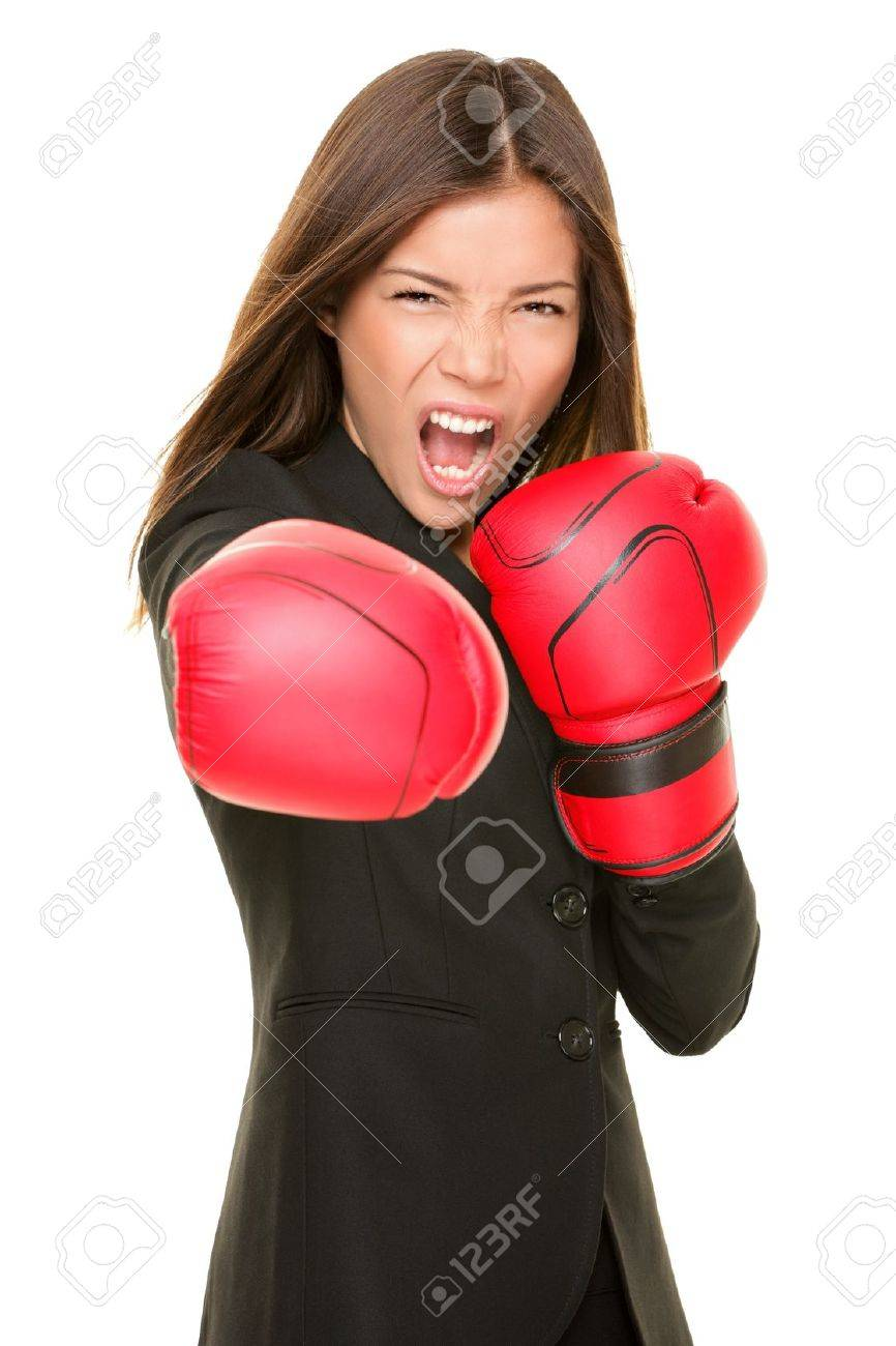 Business woman boxing punching towards camera ready to fight. Strength, power or competition concept image of beautiful strong Asian / Caucasian businesswoman isolated on white background. Stock Photo - 10132832