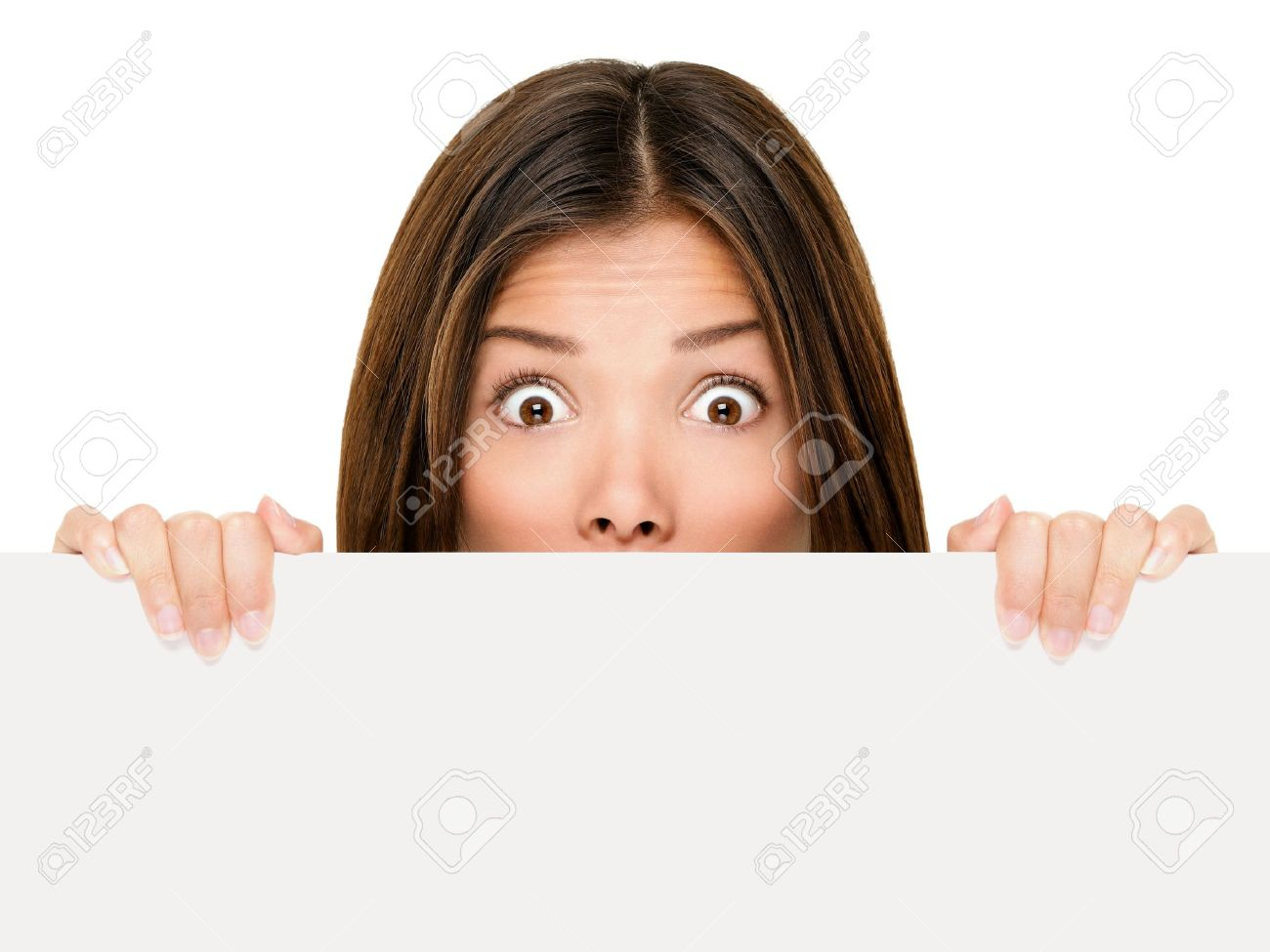 Banner sign woman peeking over edge of blank empty paper billboard with copy space for text. Beautiful Asian Caucasian woman looking surprised and scared - funny. Isolated on white background. Stock Photo - 10437892