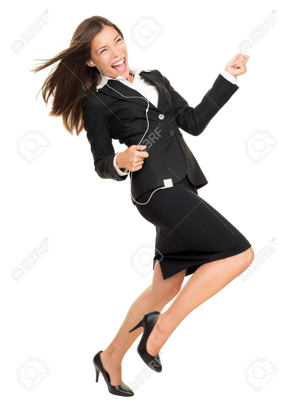 Woman listening to music on mp3 player, dancing playing air guitar. Funny happy portrait of business woman isolated on white background in full length. Stock Photo - 10437891