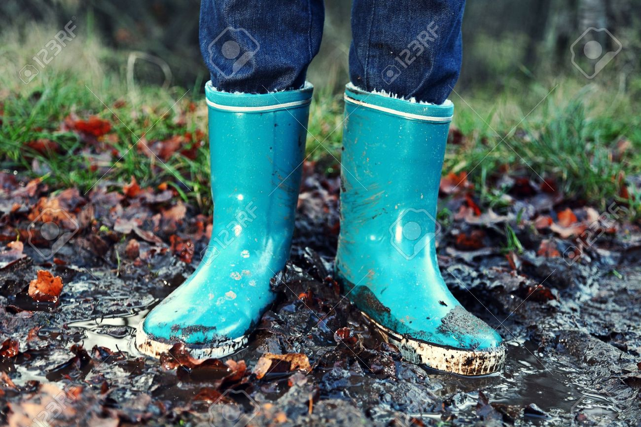 Fall / Autumn Concept - Rain Boots In Mud Puddle. Blue Woman ...
