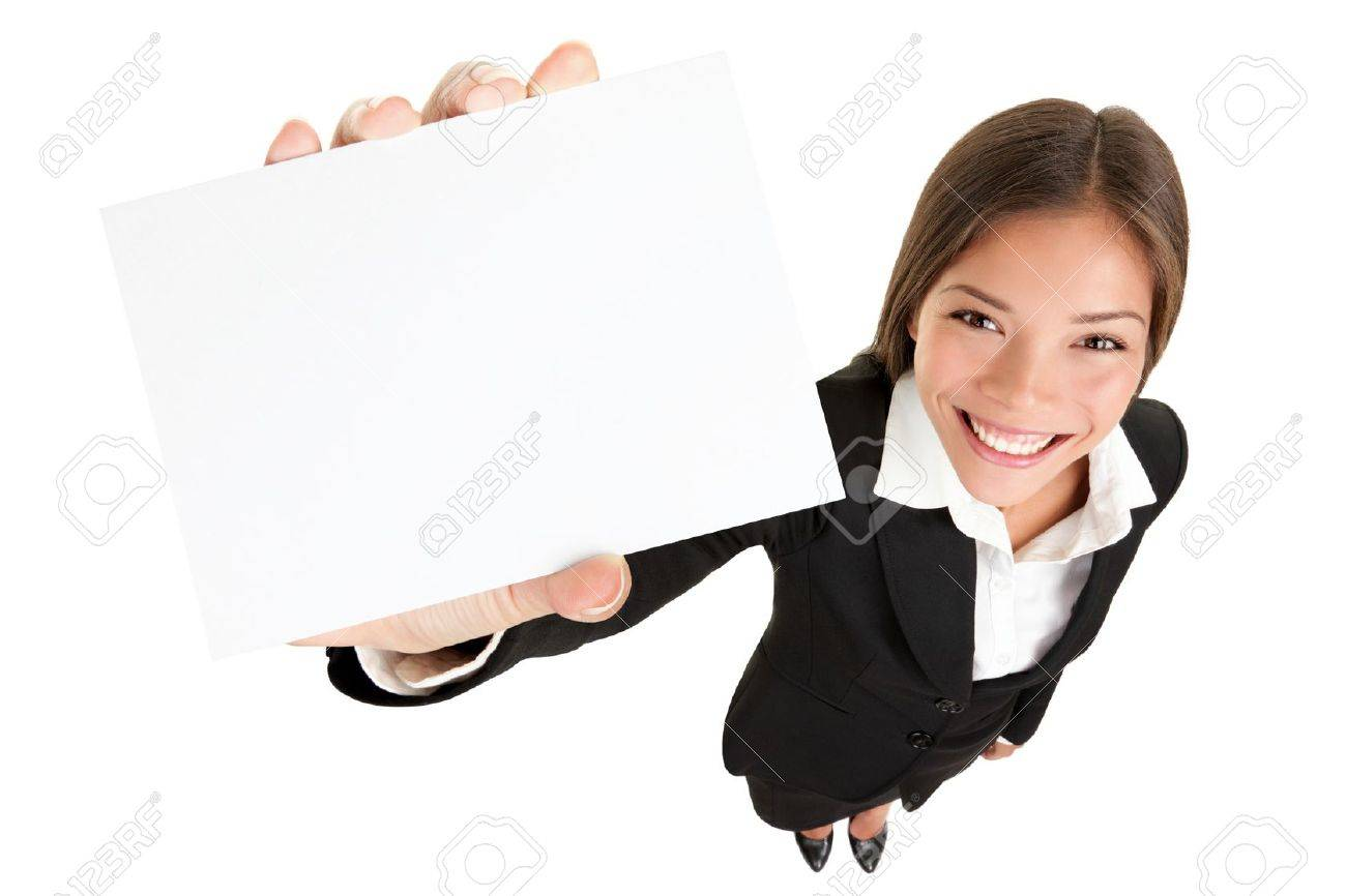 Showing sign - woman holding big business card / paper sign with lots of copy space. Sign and businesswoman face both in focus, High angle full lengh view of happy smiling mixed race Asian / Caucasian female businesswoman isolated on white background. Stock Photo - 10916741