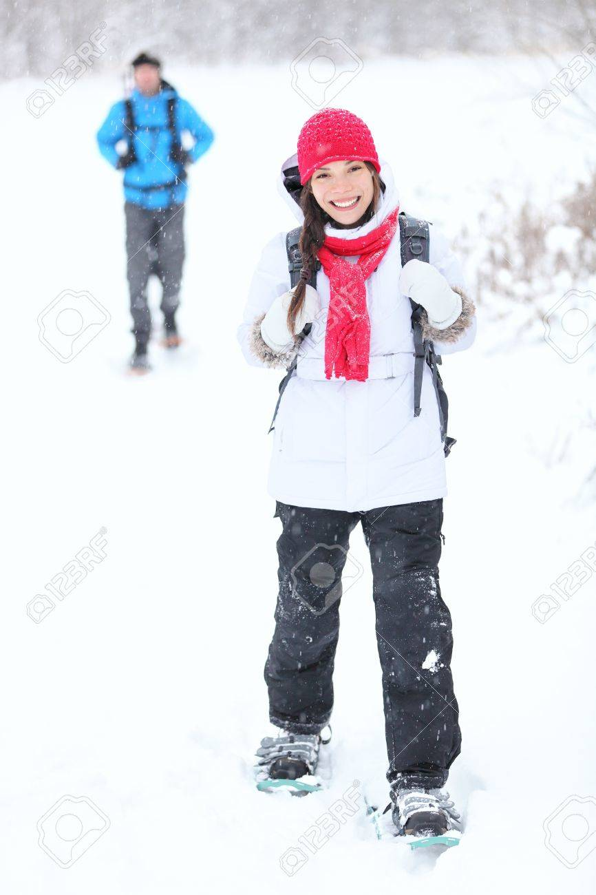 snowshoeing winter hiking. Active couple on snowshoes outdoors in snow walking in natural park in Canada, Quebec. Stock Photo - 11841035