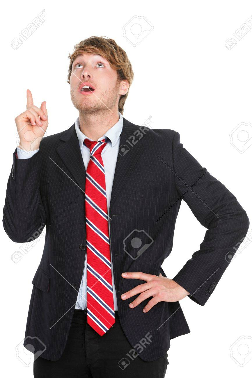 Businessman having an idea - eureka. Thinking young business man pointing up in suit isolated on white background. Stock Photo - 12056446