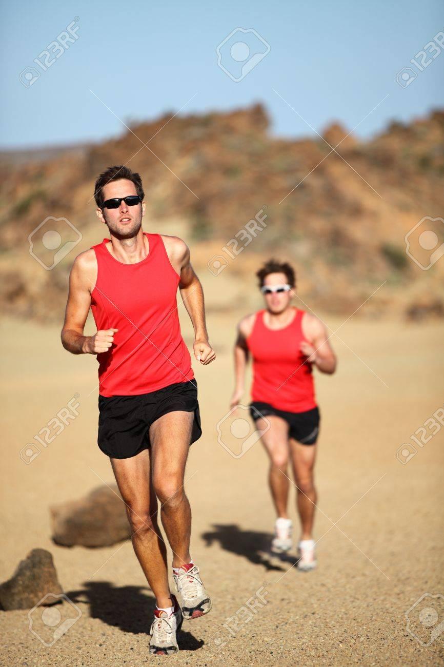 Runners running training for marathon competition in beautiful desert landscape. Stock Photo - 12720693