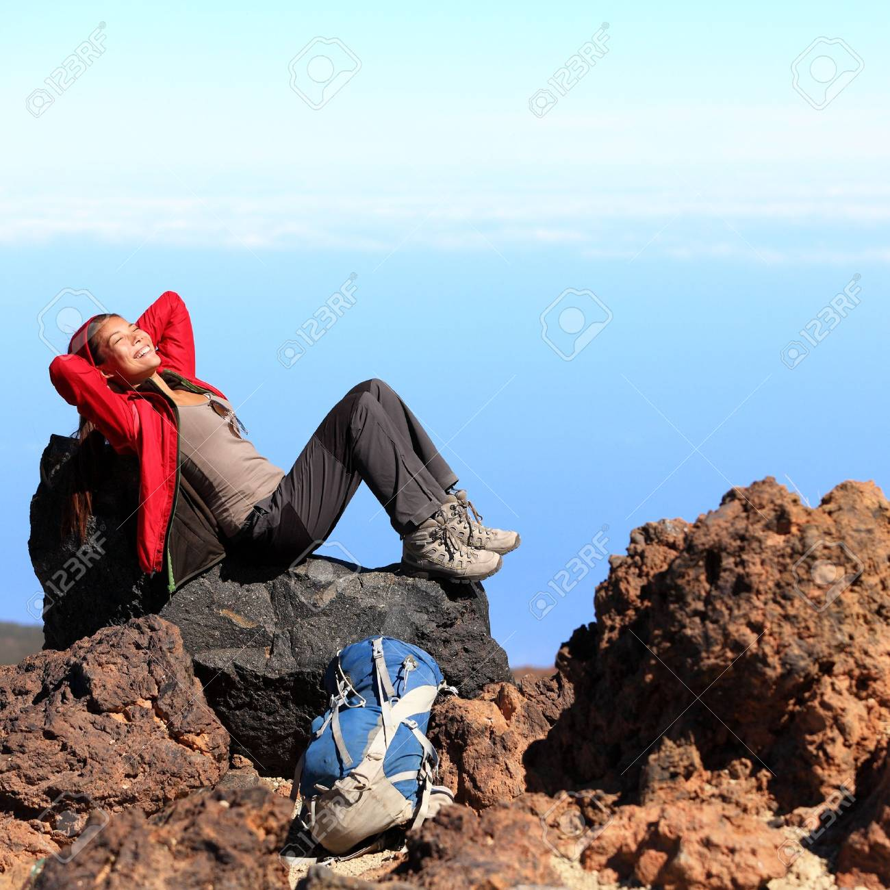 Resting relaxing woman hiker lying down enjoying the sun during hiking travel trek on volcano Teide, Tenerife, Canary Islands, Spain  Beautiful young female hiker Stock Photo - 13044752