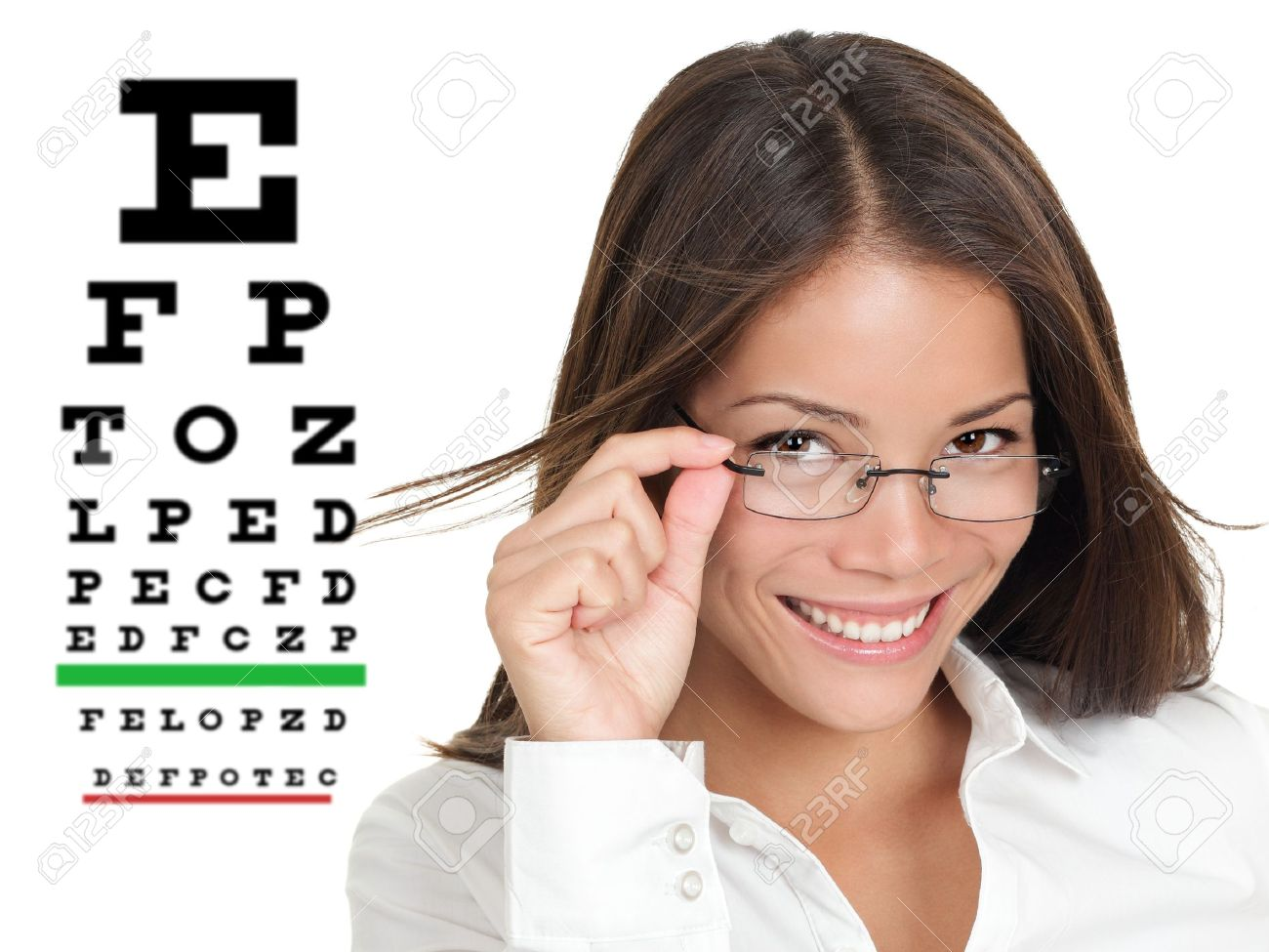 Optician or optometrist wearing glasses standing by Snellen eye exam chart  Female Caucasian   Asian Chinese model isolated on white background Stock Photo - 13281730