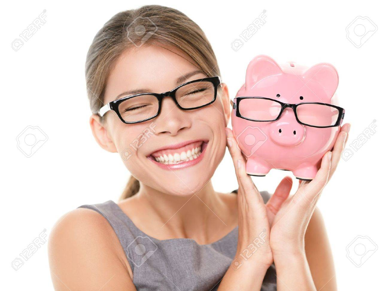 Glasses eyewear savings piggybank  Woman happy excited over saving money buying glasses  Young beautiful multiracial Caucasian   Chinese Asian woman isolated on white background Stock Photo - 13524223
