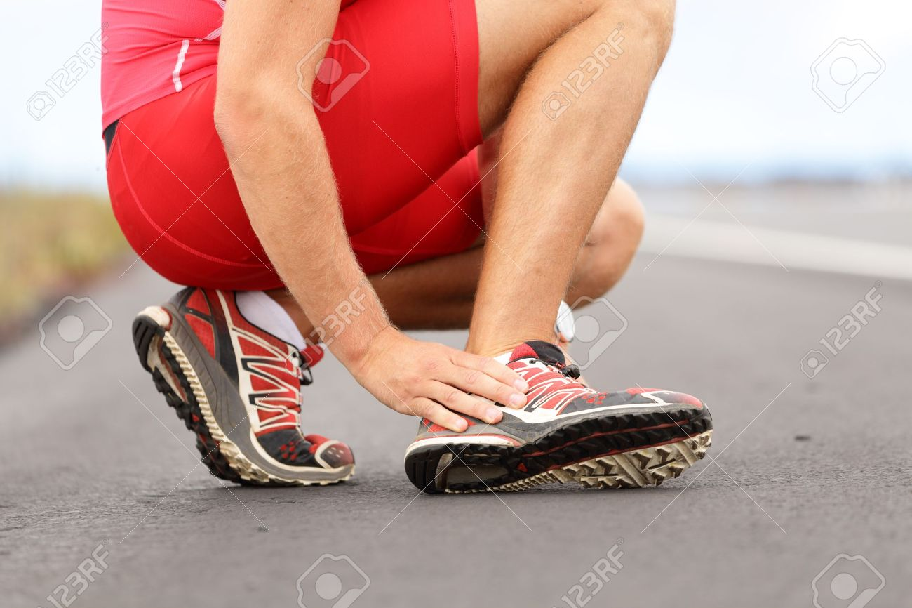 Broken twisted angle - running sport injury  Male runner touching foot in pain due to sprained ankle Stock Photo - 14899582
