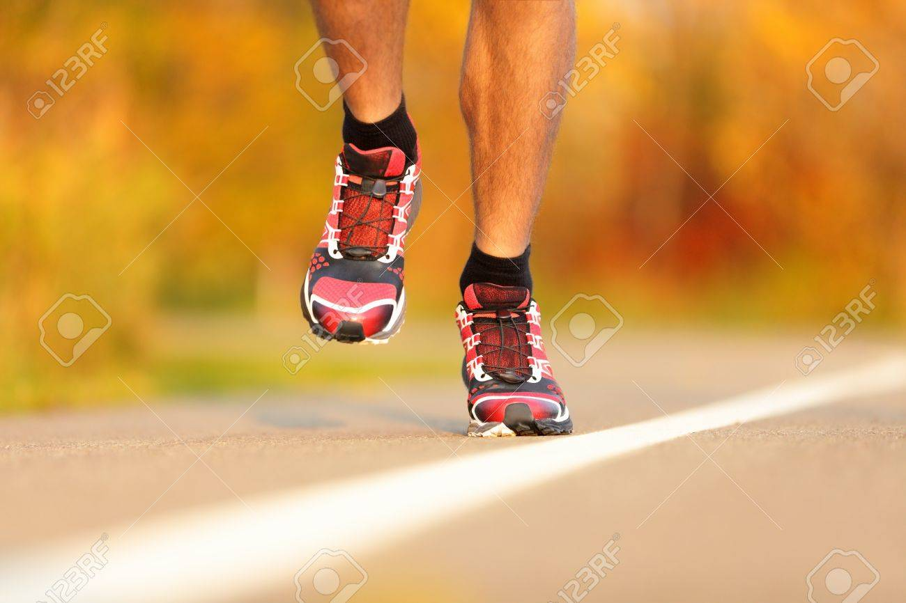 Athlete running shoes close-up  Man runner jogging outdoors in fall Stock Photo - 15150247