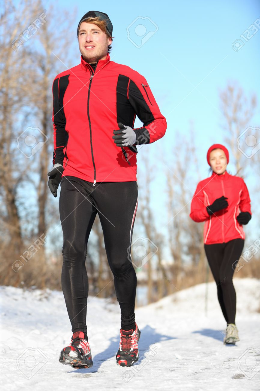 Sport in winter - People running in snow. Man and woman fitness couple. Stock Photo - 15589194