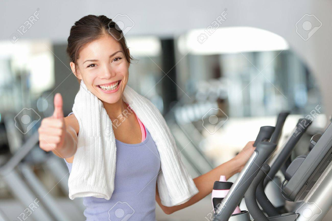 Happy fitness woman thumbs up in gym during exercise training on moonwalker treadmill. Stock Photo - 16663943