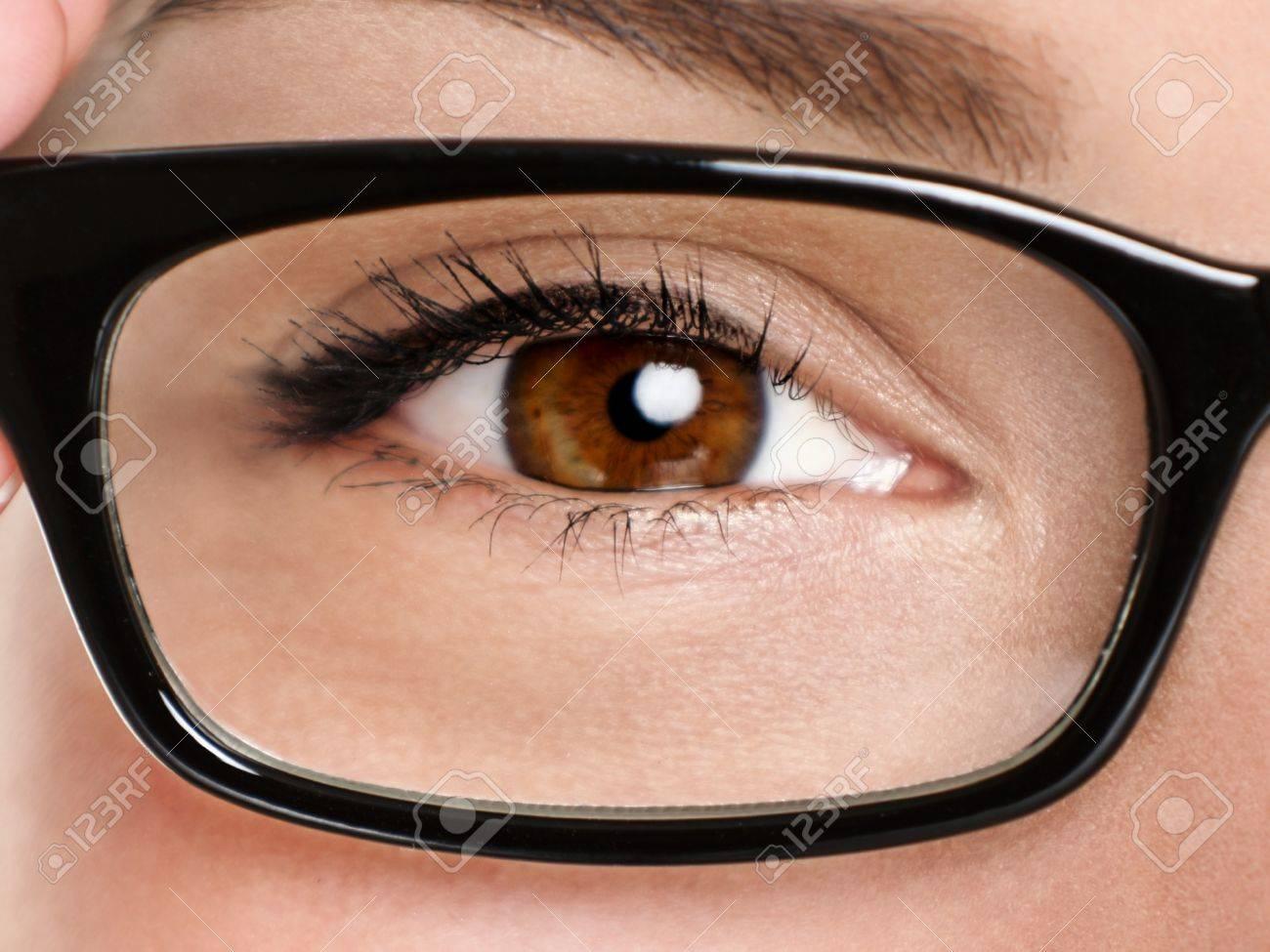 Glasses eyewear closeup. Macro of woman black eye wear glasses frame. Brown eyes of multiethnic Chinese Asian / Caucasian woman model. Stock Photo - 17153720
