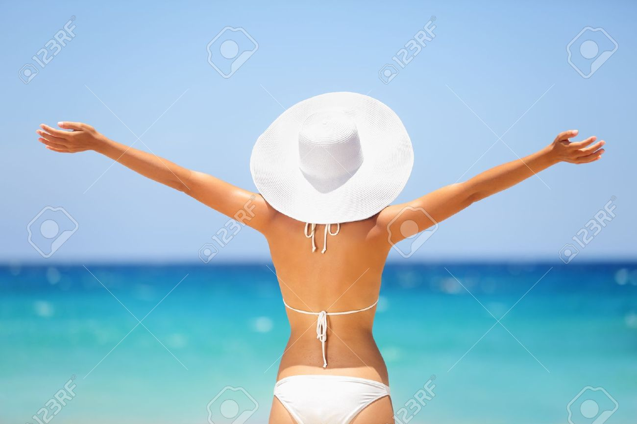 Beach summer holidays woman in happy freedom concept with arms raised out in happiness Stock Photo - 17342898