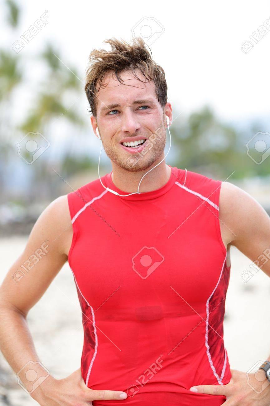 Athlete runner man sweating after running on beach= - 17418453
