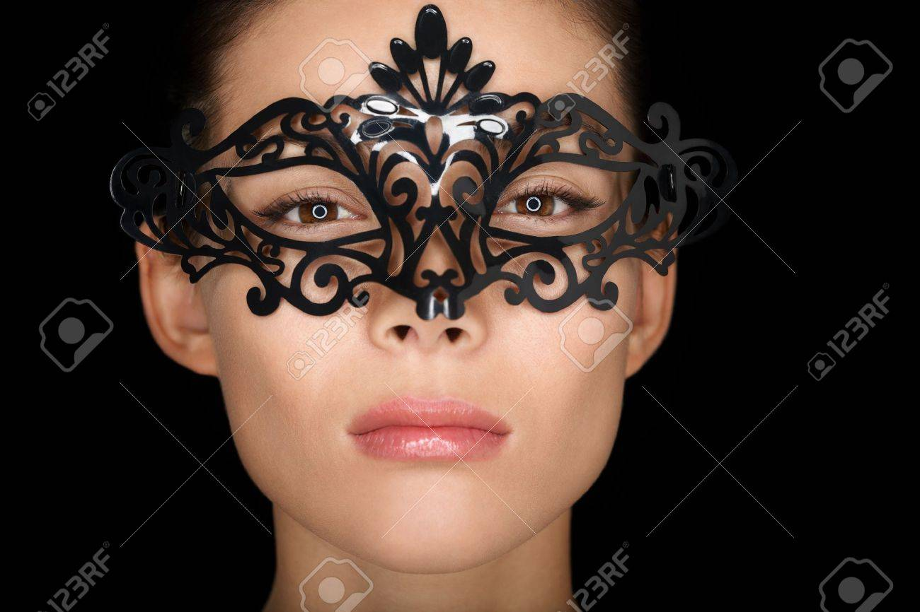 Beauty woman wearing carnival mask isolated on black background Stock Photo - 17500909
