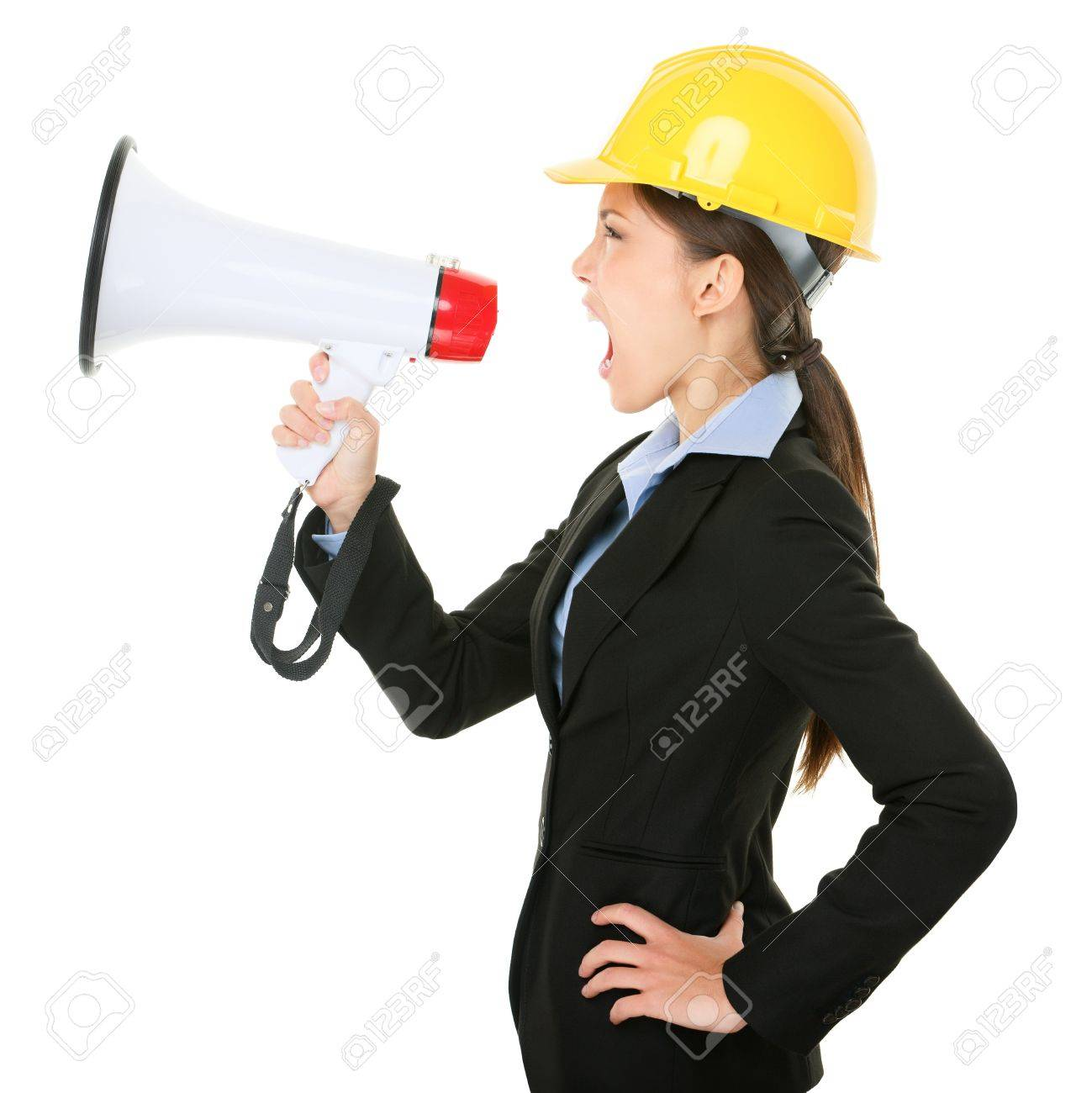 Megaphone screaming engineer contractor business woman with hard hat yelling angry Stock Photo - 18906229