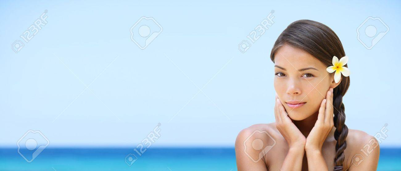 Spa woman on travel beach resort with perfect skin for beauty skin care  Beautiful mixed race Caucasian Asian ethnic girl looking serene a camera during holidays vacation  Panoramic banner on beach Stock Photo - 18969023