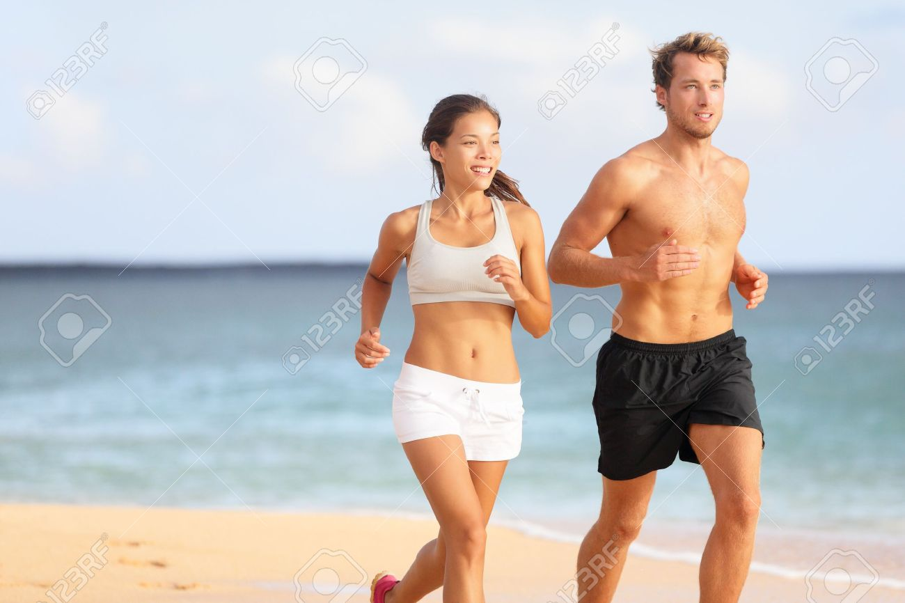 http://previews.123rf.com/images/maridav/maridav1304/maridav130400114/19226464-Couple-running-Sport-runners-jogging-on-beach-working-out-smiling-happy-Fit-male-fitness-model-and-a-Stock-Photo.jpg